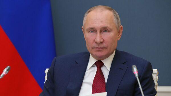 Russian President Vladimir Putin addresses the participants of the World Economic Forum's annual meeting in Davos on 27 January 2021 - Sputnik Italia