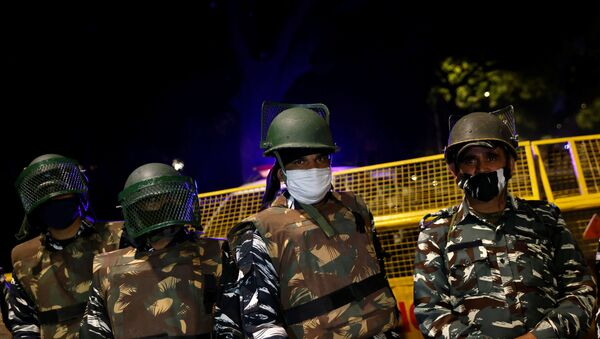 Paramilitary troops stand guard after an explosion near the Israeli embassy in New Delhi, India, January 29, 2021. - Sputnik Italia