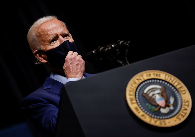 U.S. President Joe Biden removes his mask to address NIH staff during a visit to NIH in Bethesda, Maryland, U.S., February 11, 2021.