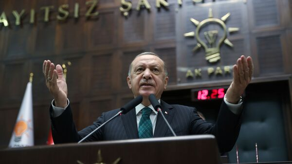 Turkish President Tayyip Erdogan addresses members of parliament from his ruling AK Party (AKP) during a meeting at the Turkish parliament in Ankara, Turkey, February 10, 2021 - Sputnik Italia