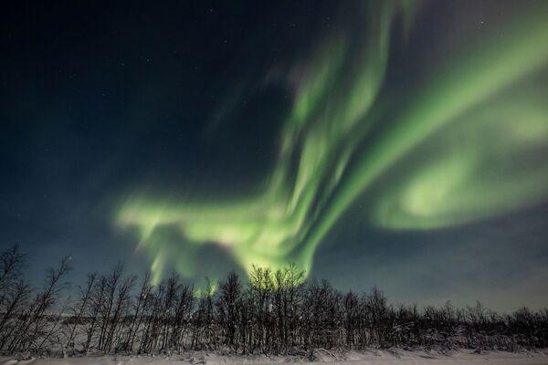 Aurora boreale nei cieli del comune finlandese di Enontekiö in Lapponia.  - Sputnik Italia