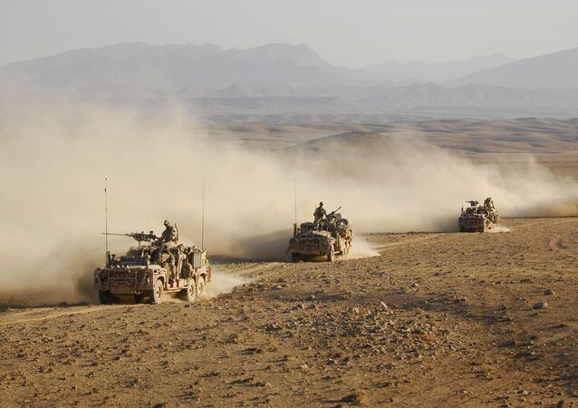 Australian Special Operations Task Groups Long Range Patrol Vehicles drive in convoy across one of Afghanistan's desert