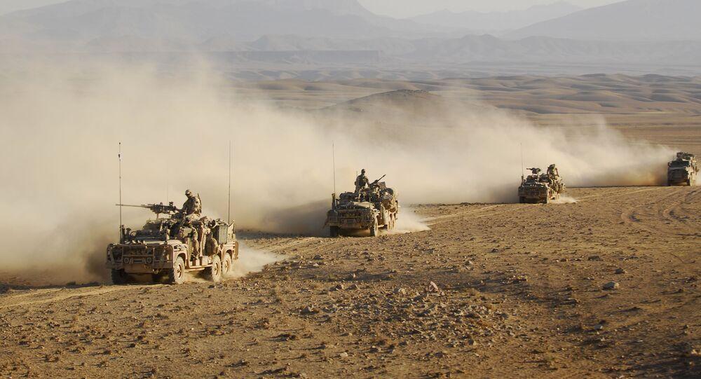 Australian Special Operations Task Groups Long Range Patrol Vehicles drive in convoy across one of Afghanistan's desert