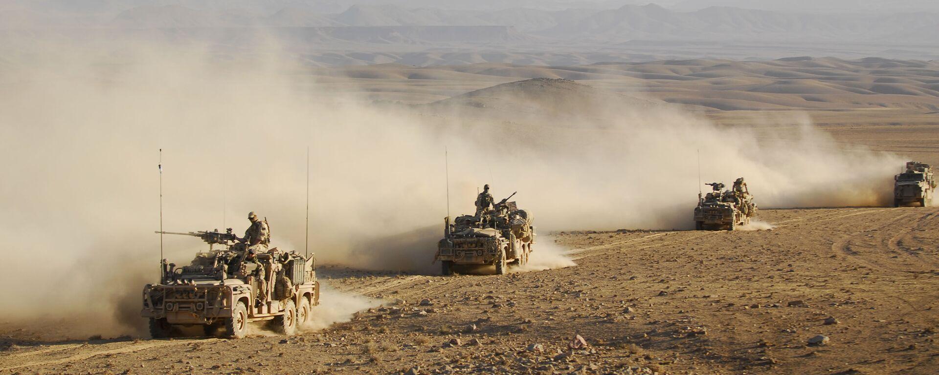 Forze speciali australiane su veicoli di pattuglia a lungo raggio guidano in convoglio attraverso uno dei deserti dell'Afghanistan (File) - Sputnik Italia, 1920, 11.09.2021