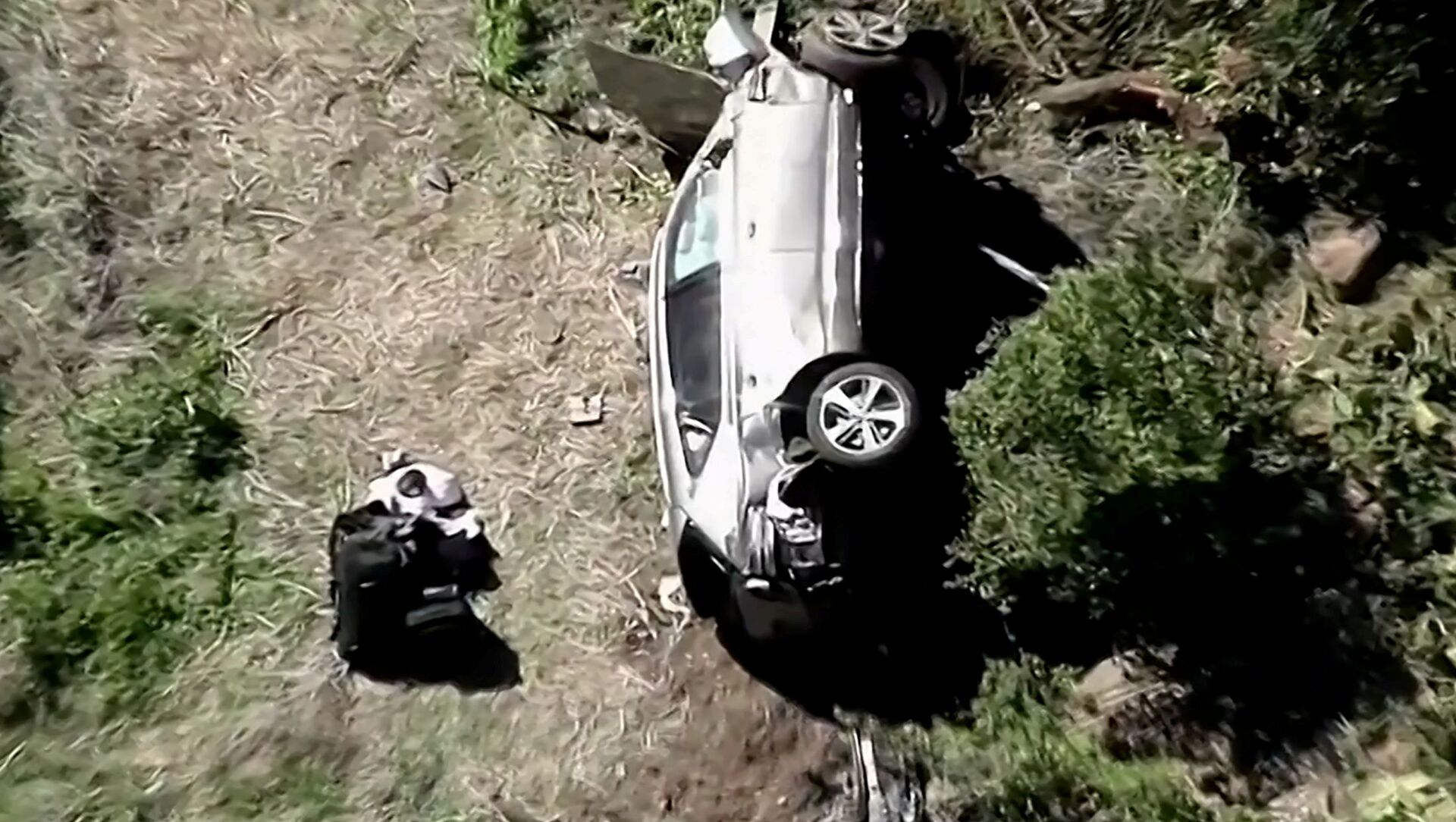 The vehicle of golfer Tiger Woods, who was rushed to hospital after suffering multiple injuries, lies on its side after being involved in a single-vehicle accident in Los Angeles, California, U.S. in a still image from video taken February 23, 2021 - Sputnik Italia, 1920, 24.02.2021
