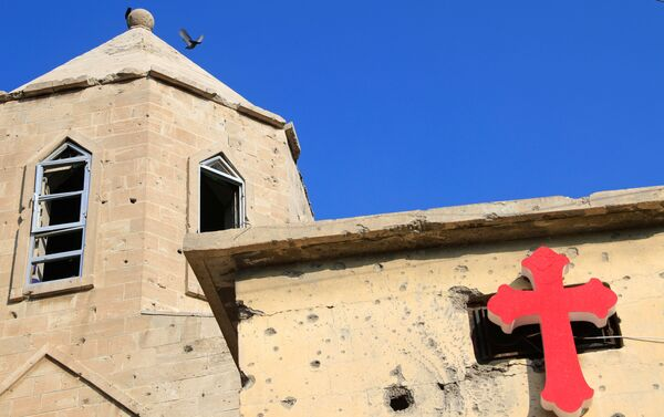 La foto della croce sul muro di una chiesa a Mosul  - Sputnik Italia