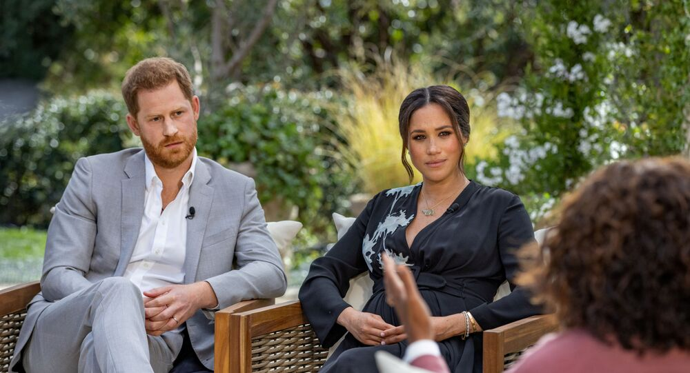 Britain's Prince Harry and Meghan, Duchess of Sussex, are interviewed by Oprah Winfrey in this undated handout photo.
