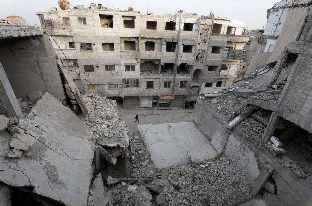 Case distrutte nella città siriana di Douma, il 9 marzo 2021