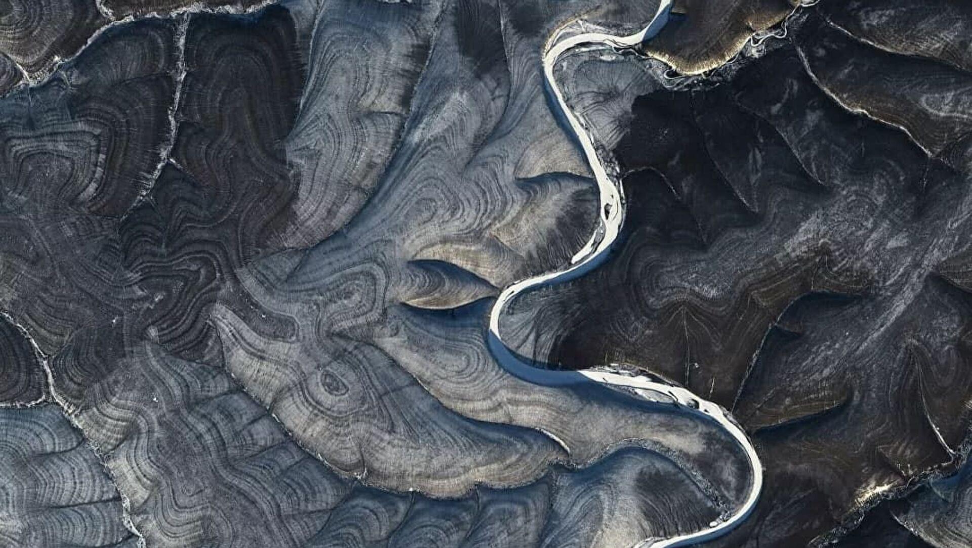 Le immagini del fiume Marcha in Siberia scattate dal satellite Landsat 8 - Sputnik Italia, 1920, 22.03.2021