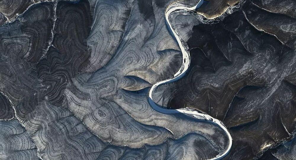 Le immagini del fiume Marcha in Siberia scattate dal satellite Landsat 8