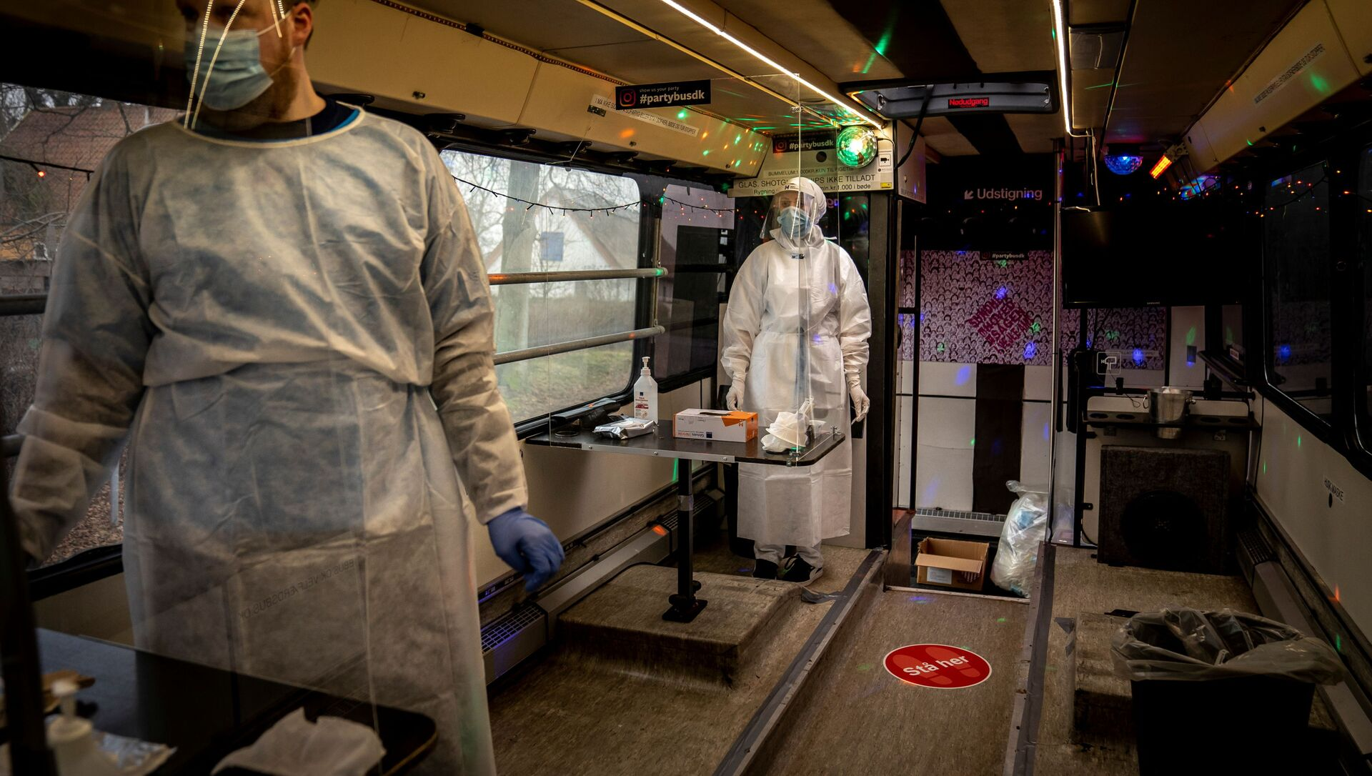 Healthcare workers wait in the Partybus, where people can listen to music while being tested for the coronavirus disease (COVID-19), in Ishoej, Denmark February 23, 2021 - Sputnik Italia, 1920, 01.04.2021