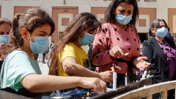 Верующие после пасхального богослужения в Багдаде  - Sputnik Italia