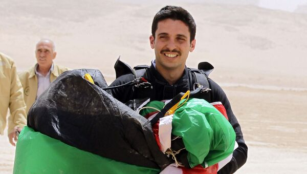In this file photo taken on April 17, 2012 shows Jordanian Prince Hamzah bin al-Hussein, president of the Royal Aero Sports Club of Jordan, carries a parachute during a media event to announce the launch of Skydive Jordan, in the Wadi Rum desert. - A top former Jordanian royal aide was among several suspects arrested on April 3, 2021, as the army cautioned Prince Hamzah bin Hussein, the half-brother of King Abdullah II against damaging the country's security. - Sputnik Italia