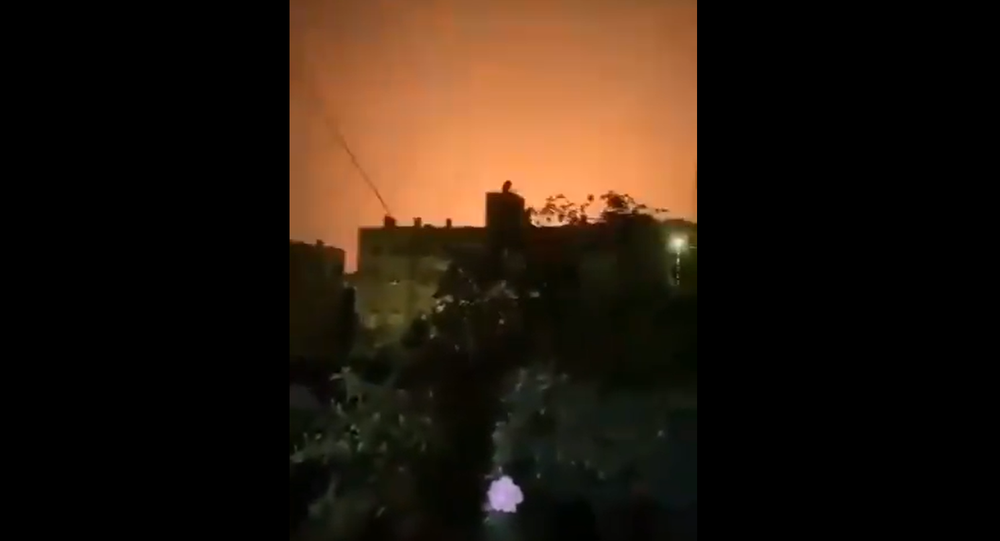 Screenshot from a video allegedly showing explosions lighting up the sky above Damascus area after what was described as Israeli aggression
