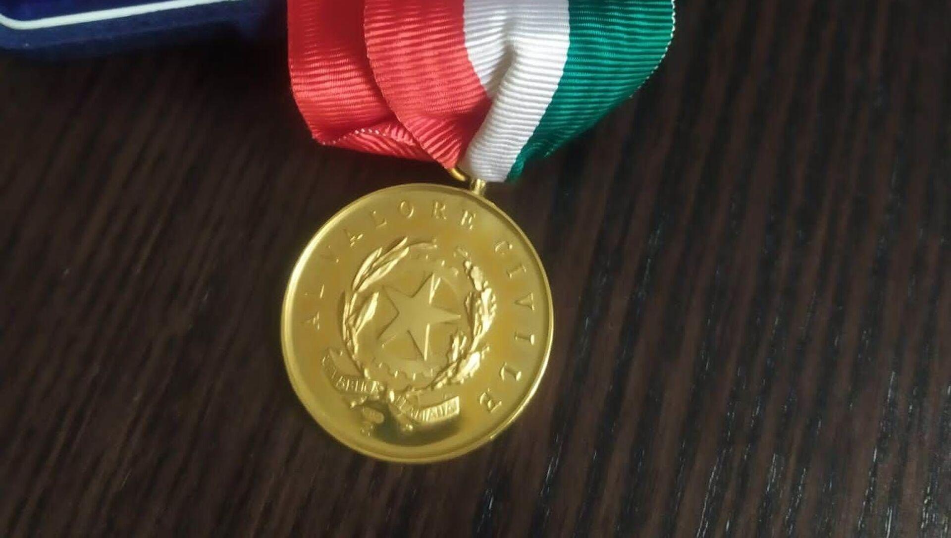 Medaglia d'Oro al Valor Civile alla memoria di Fabrizio Quattrocchi  - Sputnik Italia, 1920, 18.05.2021