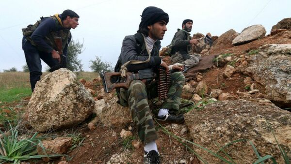 Fighters from the Al-Nusra Front, Al-Qaeda's Syria branch, hold a position as they fight against forces loyal to the regime - Sputnik Italia