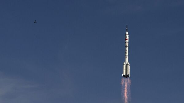 Старт ракеты-носителя Чанчжэн-2F c космодрома Цзюцюань, КНР. Архивное фото - Sputnik Italia