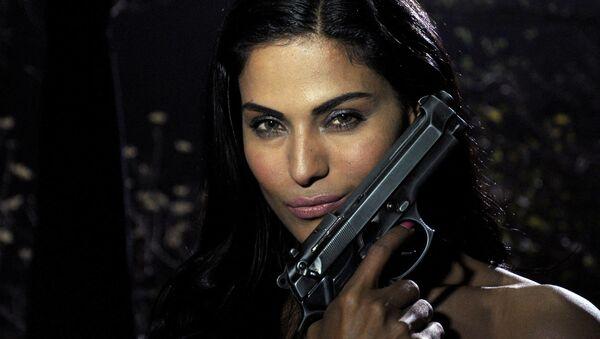 "Pakistani actress Veena Malik poses on the set of her forthcoming Hindi film ""Mumbai 125 kms"" in Mumbai on March 21, 2012 - Sputnik Italia"