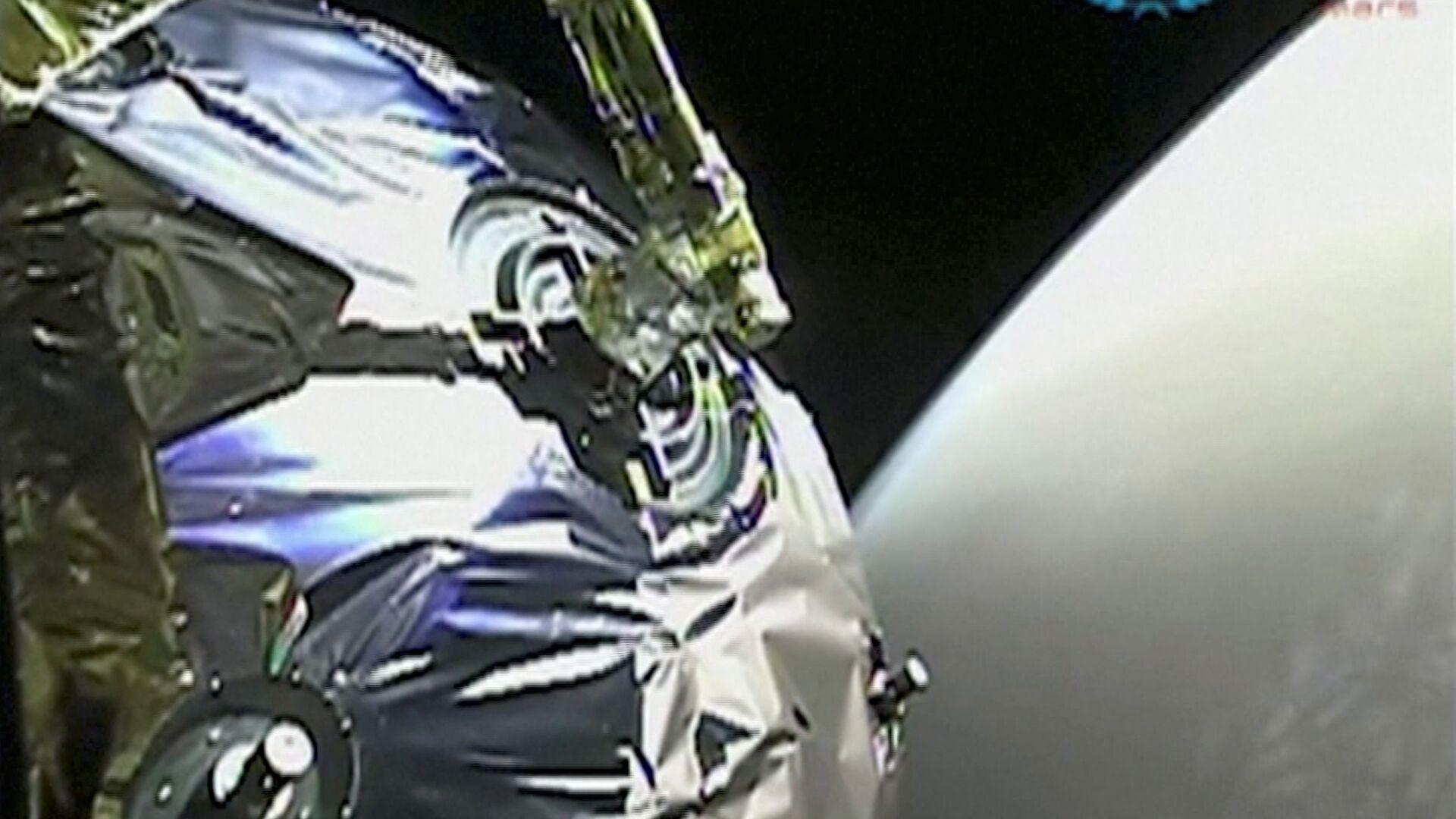 La vista dalla sonda Tianwen-1 mentre entra nell'orbita di Marte in questo screenshot ottenuto da un video il 12 febbraio 2021. - Sputnik Italia, 1920, 15.05.2021
