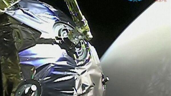 La vista dalla sonda Tianwen-1 mentre entra nell'orbita di Marte in questo screenshot ottenuto da un video il 12 febbraio 2021. - Sputnik Italia