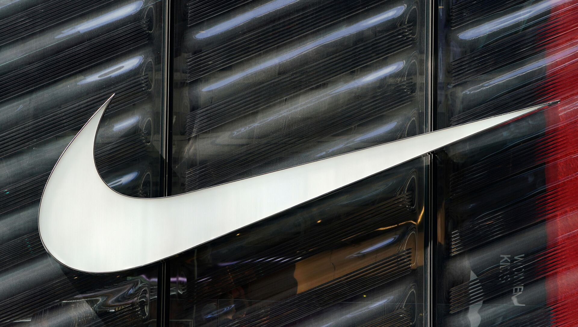 FILE PHOTO: The Nike swoosh logo is seen outside the store on 5th Ave in New York, New York, U.S., March 19, 2019.   - Sputnik Italia, 1920, 16.05.2021