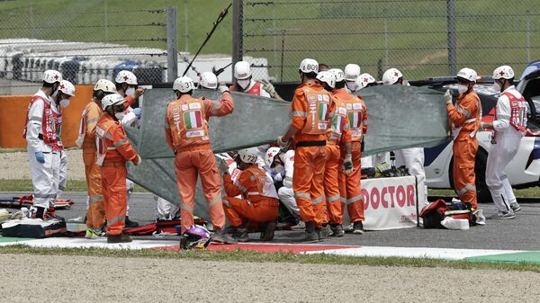 Швейцарский мотогонщик Jason Dupasquier после аварии на Moto3  - Sputnik Italia