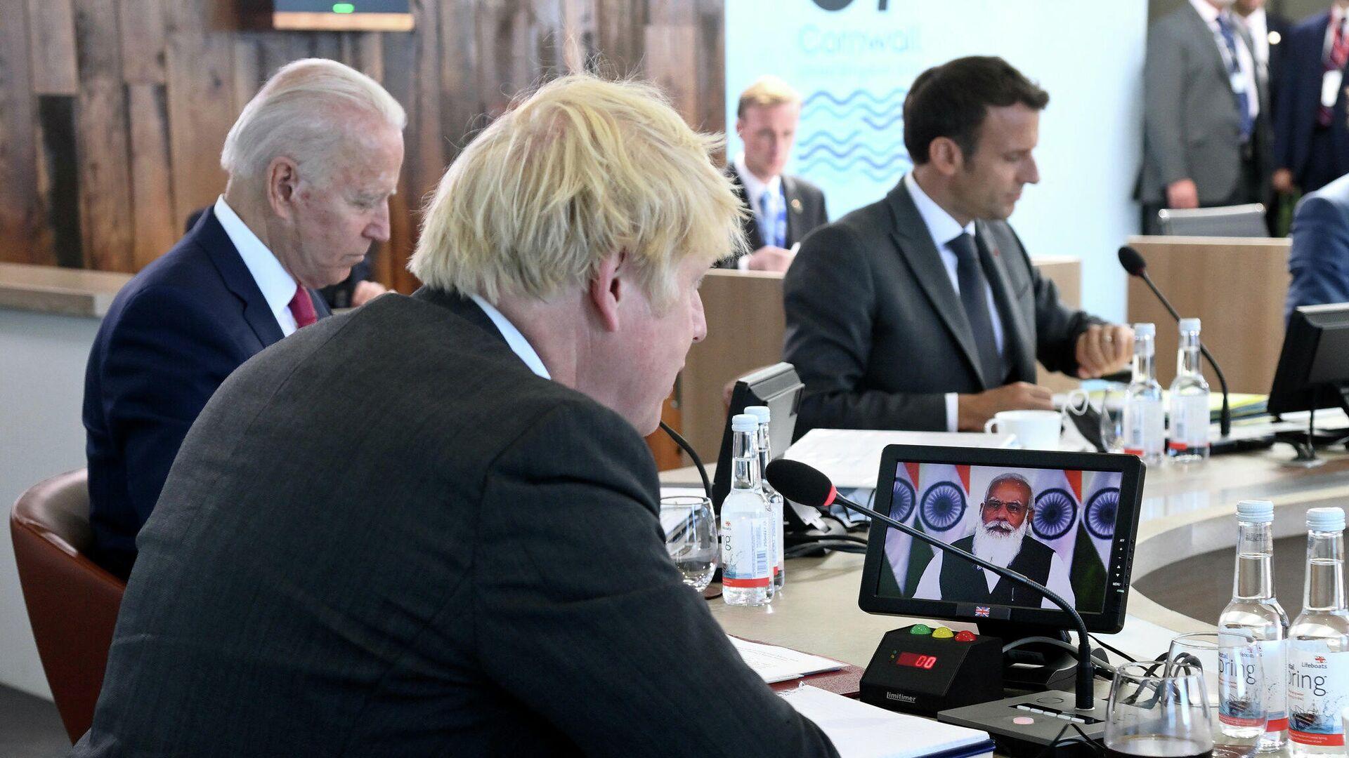 Macron e Biden al G7 della Cornovaglia: insieme a loro il premier britannico Johnson - Sputnik Italia, 1920, 12.06.2021