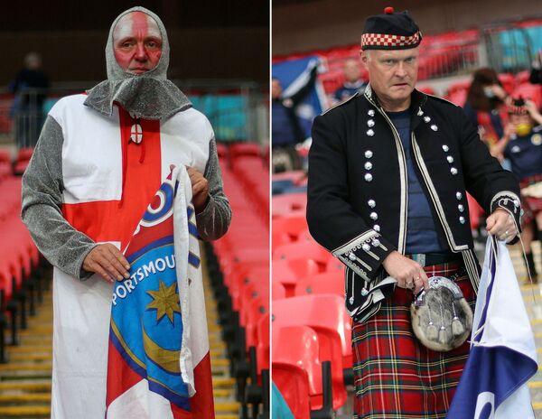 Un tifoso dell'Inghilterra (a sinistra) e un tifoso della Scozia prima della partita tra Inghilterra e Scozia allo stadio di Wembley a Londra, il 18 giugno 2021. - Sputnik Italia