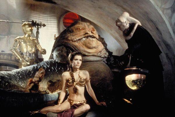 """Carrie Fisher in un bikini in bronzo nell'episodio """"Star Wars - il ritorno dello Jedi"""", 1983. - Sputnik Italia"""