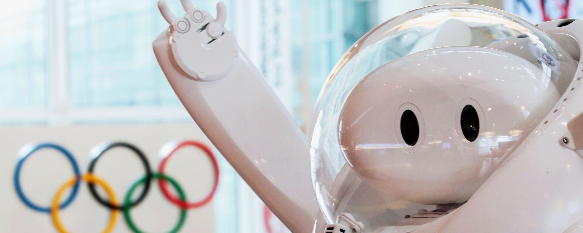 Робот у информационной стойки в аэропорту Haneda  - Sputnik Italia, 1920, 08.08.2021
