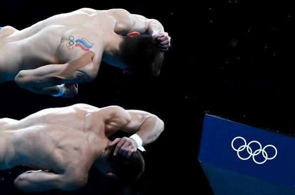 Atleti russi, membri della squadra nazionale russa di tuffi, Alexander Bondar e Viktor Minibayev, durante la gara del tuffo sincronizzato 10 metri ai Giochi Olimpici di Tokyo. - Sputnik Italia