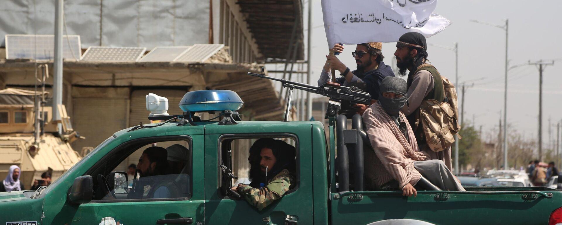 Afghanistan, Talebani a bordo di un veicolo della polizia - Sputnik Italia, 1920, 29.08.2021
