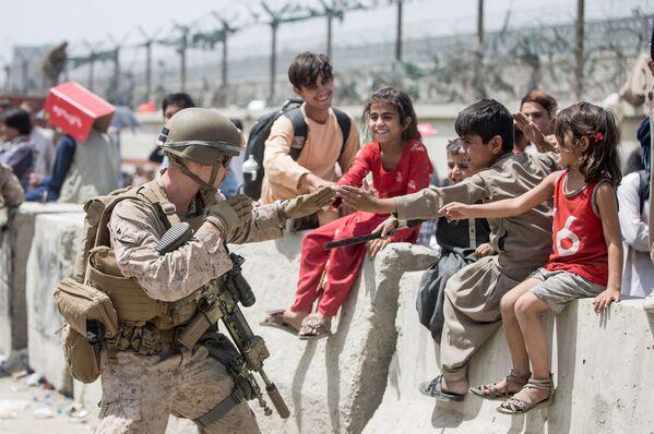 Nella notte tra il 15 e il 16 agosto, il portavoce dell'ufficio politico dei Talebani, Mohammad Naeem, ha annunciato la fine della guerra in Afghanistan. - Sputnik Italia