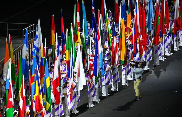 La parte centrale della cerimonia è stata, come al solito, caratterizzata dalla parata delle varie delegazioni nazionali. - Sputnik Italia