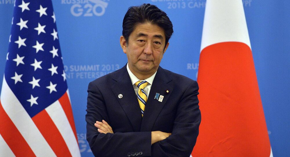 Japan's Prime Minister Shinzo Abe waits for US President to arrive for a bilateral meeting on the sideline of the G20 summit in Saint Petersburg on September 5, 2013