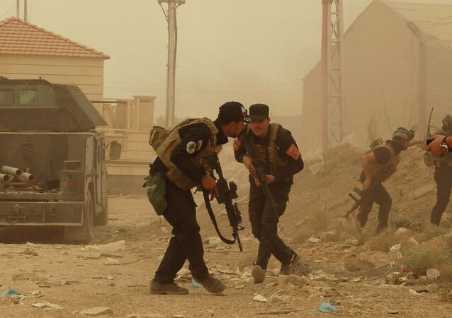 Security forces defend their headquarters against attacks by Islamic State extremists during sand storm in the eastern part of Ramadi, the capital of Anbar province, 115 kilometers (70 miles) west of Baghdad, Iraq, Thursday, May 14, 2015