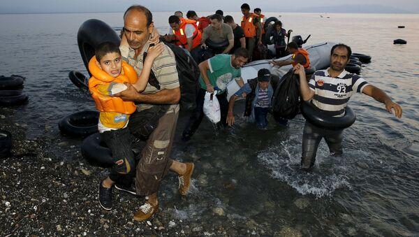 I rifugiati siriani sono arrivati alla costa greca dopo passaggio attraverso mar Egeo dalla Turchia. - Sputnik Italia