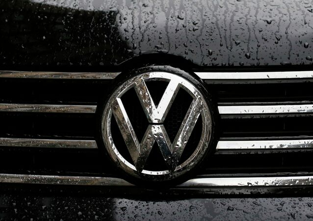 Raindrops are seen on the badge of a diesel Volkswagen Passat in central London, Britain September 22, 2015