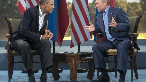 Vladimir Putin e Barack Obama al summit del G8 il 17 giugno 2013 - Sputnik Italia