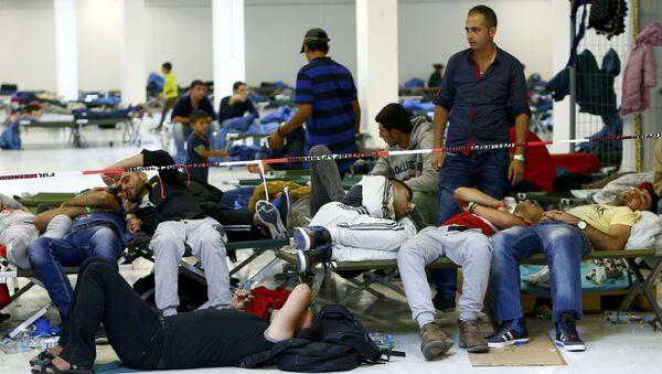 Migranti in un centro di accoglienza in Germania - Sputnik Italia