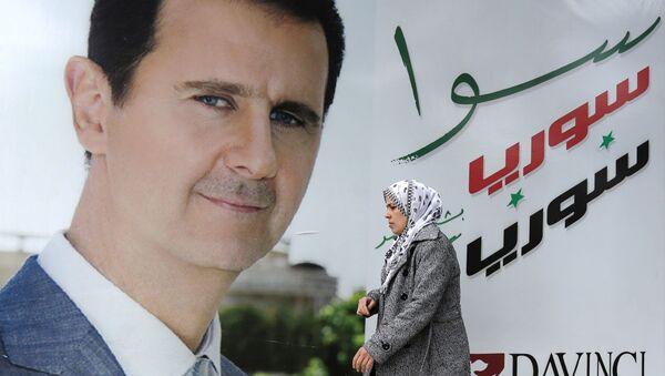 Un poster di Bashar Assad - Sputnik Italia