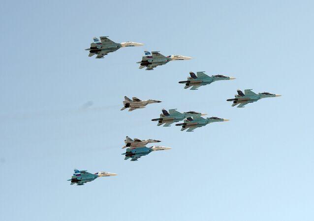 A group of 10 aircraft: Sukhoi 34 aircraft, Sukhoi 27 aircraft and MiG 29 aircraft