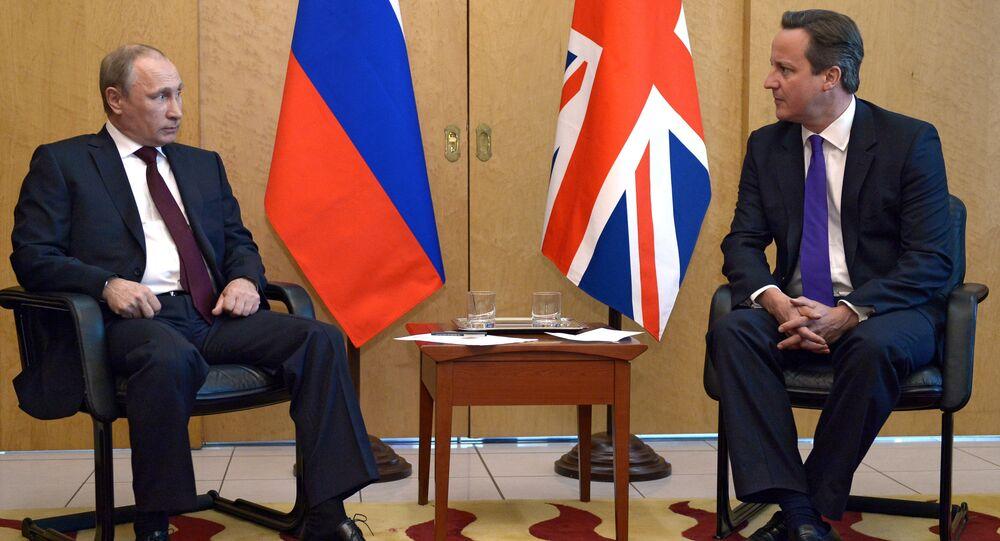 Vladimir Putin e David Cameron