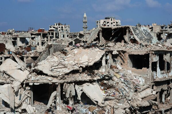 Le case distrutte nella città siriana di Homs. - Sputnik Italia