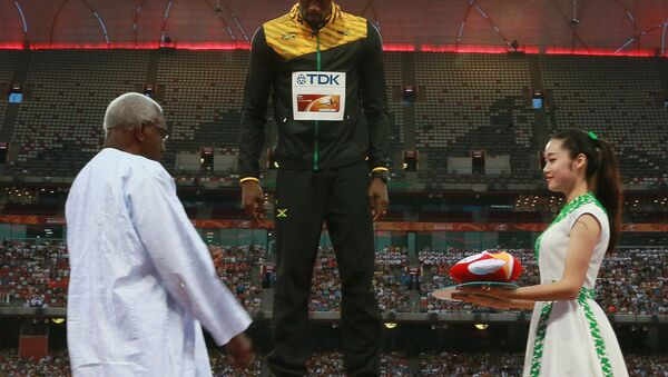 Lamine Diack premia Husain Bolt ai Mondiali di Pechino del 2015 - Sputnik Italia