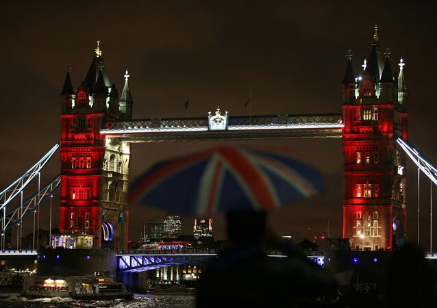 London's iconic Tower Bridge, illuminated in blue, white and red lights, resembling the colours of the French national flag, in London on November 14, 2015, as Britons express their solidarity with France following a spate of coordinated attacks that left 129 dead in Paris on November 13.