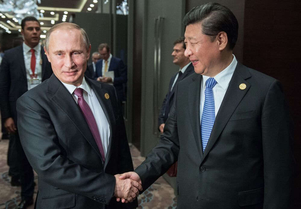 Il presidente russo Vladimir Putin e il presidente della Repubblica popolare cineseal vertice G20 in Turchia.