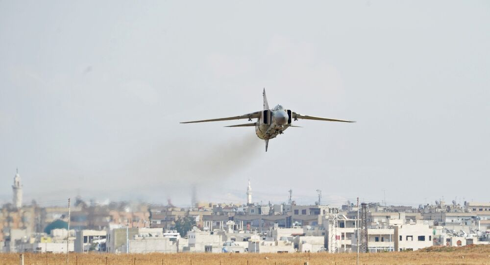 A MiG-23 aircraft of the Syrian Air Force lands at the Hama airbase near the city of Hama, Syria's Hama Province.