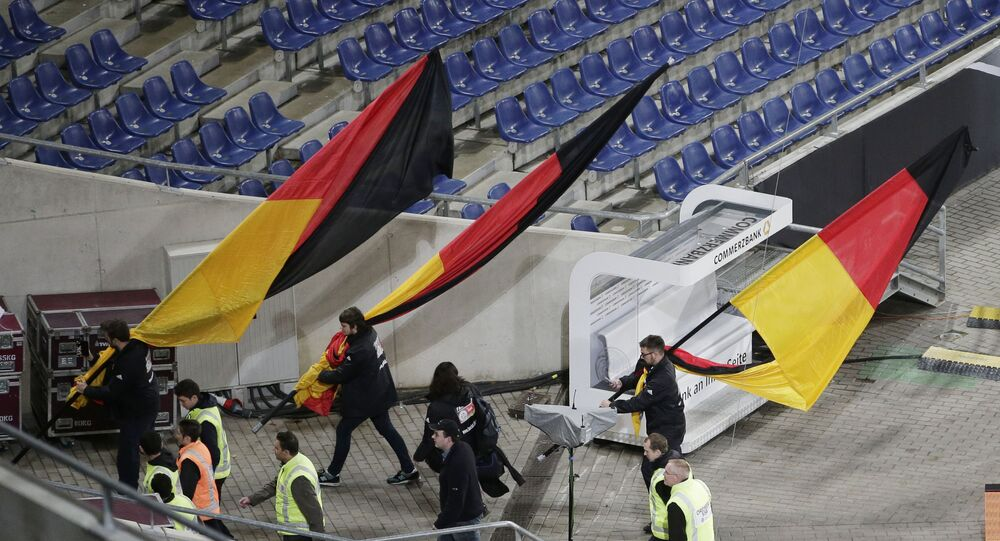 German flags are carried out of the stadium as the soccer friendly between Germany and the Netherlands was cancelled in Hannover, Germany, Tuesday, Nov. 17, 2015.