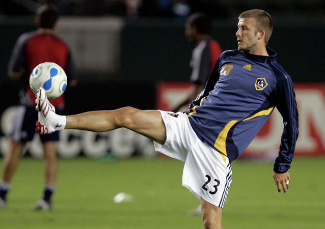 Los Angeles Galaxy's David Beckham warms up before the Galaxy's MLS soccer match with New York Red Bulls in Carson, Calif.